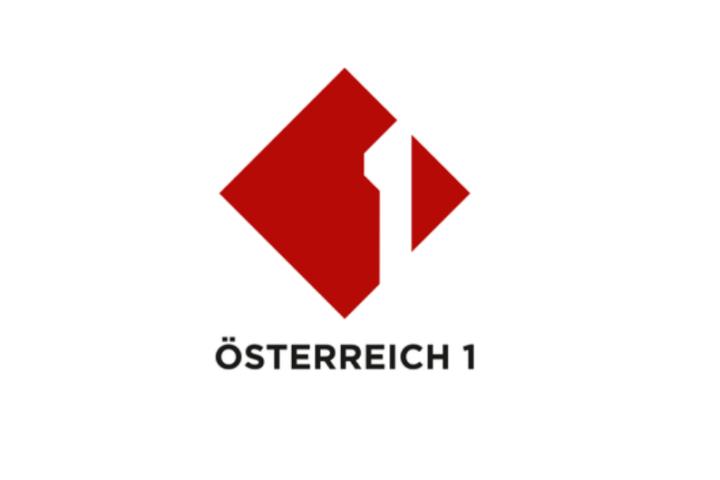 rotes, auf ein Eck gestelltes Quadrat mit weißem Einser im rechten Drittel, auf weißem Hintergrund, mit schwarzer Schrift